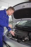Mechanic showing an engine