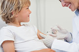 Doctor giving to a child an injection