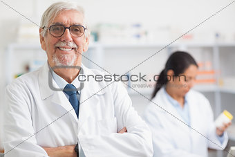 Pharmacist looking at camera with arms crossed