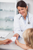 Female doctor giving a prescription
