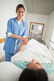 Nurse holding hand of a female patient