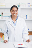 Female pharmacist smiling while looking at camera