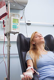 Woman receiving a blood donation while sitting