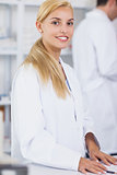 Blonde pharmacist looking at camera