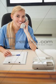 Blonde nurse holding a phone