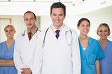 Doctors with nurses looking at camera