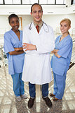 Doctor and nurses looking at camera
