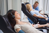 Patient listening music while being transfused
