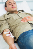Male transfused lying on a bed