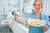 Nurse holding a plate of biscuits