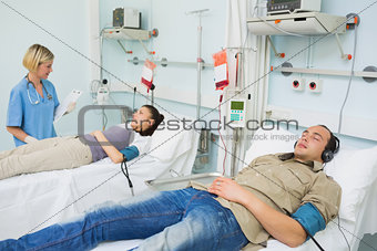 Patients lying on beds