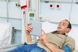 Transfused patient using a tablet computer