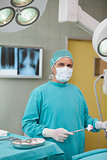 Surgeon holding a surgical tool