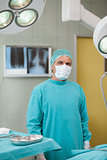 Serious surgeon standing