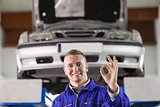 Mechanic doing a gesture with his fingers