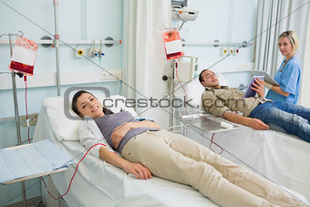 Transfused patient lying on a medical bed