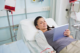 Female patient holding a tablet computer