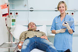 Nurse next to a male transfused patient