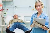Nurse next to a male patient