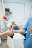 Nurse shaking hand of a transfused patient