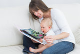 Mother reading a book with a baby