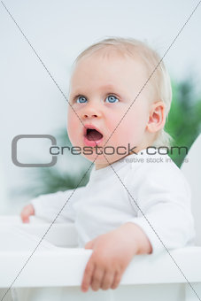 Baby sitting on a high chair