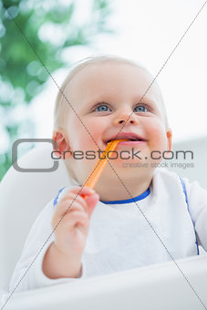 Baby biting a plastic spoon