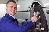 Mechanic changing a car wheel