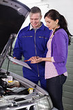 Mechanic standing next to a client