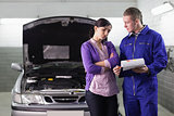 Mechanic showing the quotation to a client