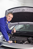 Mechanic with his thumb up while smiling