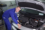 Mechanic repairing an engine of car