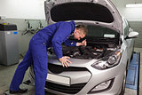 Mechanic looking at a car engine