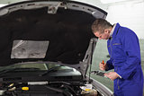 Mechanic holding a clipboard