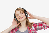 Woman closing eyes while listening music