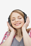 Woman with closed eyes listening music