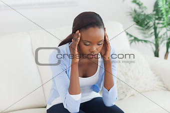 Black woman holding her head