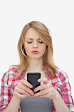Annoyed woman using a mobile phone