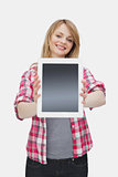 Woman presenting a tablet computer