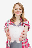 Focus of a woman holding a piggy bank