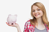 Woman holding a piggy bank on her hand