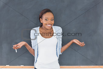 Black woman hesitating while smiling