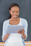 Front view of a black woman looking at a tablet computer