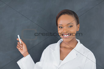 Black woman holding a chalk while smiling