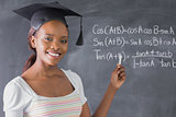 Student smiling while showing the blackboard