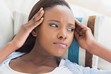 Black woman having pains on the head