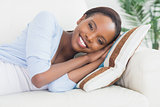 Black woman lying on side