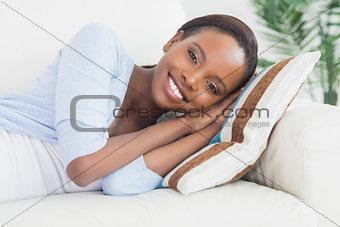 Black woman lying on side