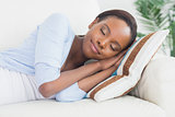 Black woman sleeping while lying on side