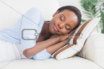 Black woman sleeping while lying on side